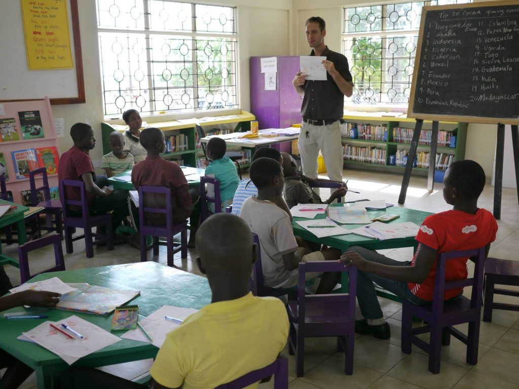 James teaching school aged children
